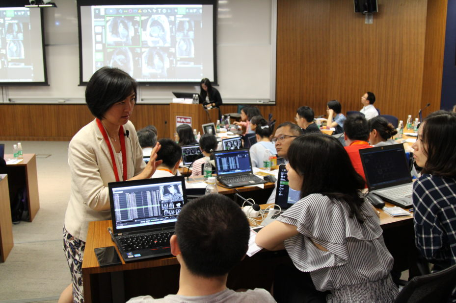 Penn Medicine's Yuchi Han discusses case studies with cardiologists attending the 2017 Penn China Advanced Cardiovascular Imaging Training Course at the Penn Wharton China Center in Beijing.